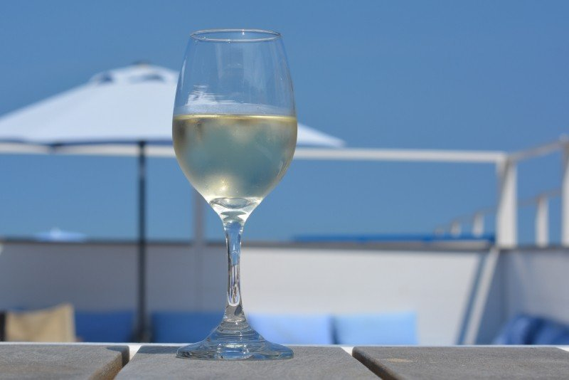wine-glass-holiday-parasol-blue-sky-beach-bar